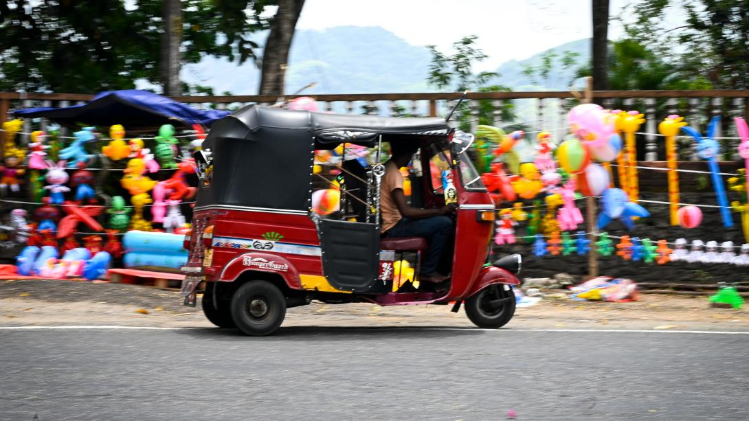 A tuk tuk driving through Sri Lanka.